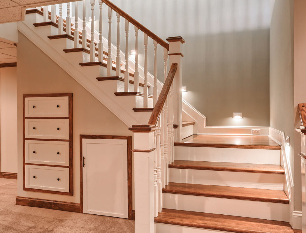 custom staircase with built in storage area