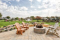 hardscaped patio area with seating and firepit