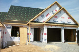 home builders in progress on a garage exterior