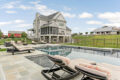 poolside looking at the back of a home built by Metzler Home Builders