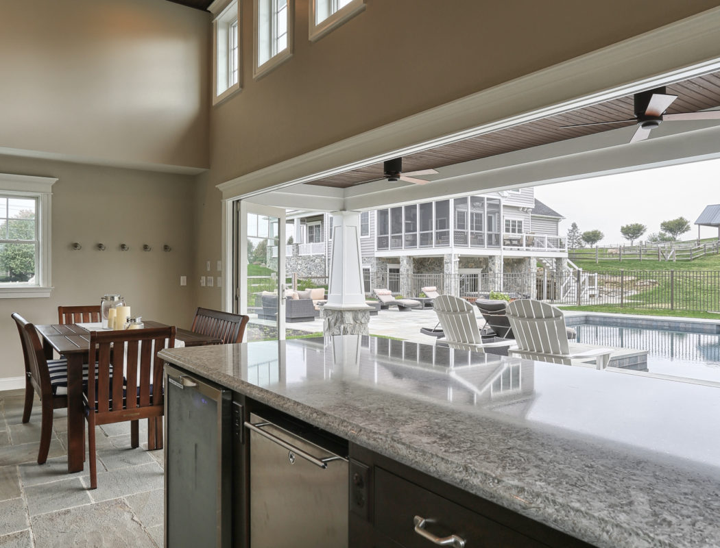 bar and dining area inside a pool house