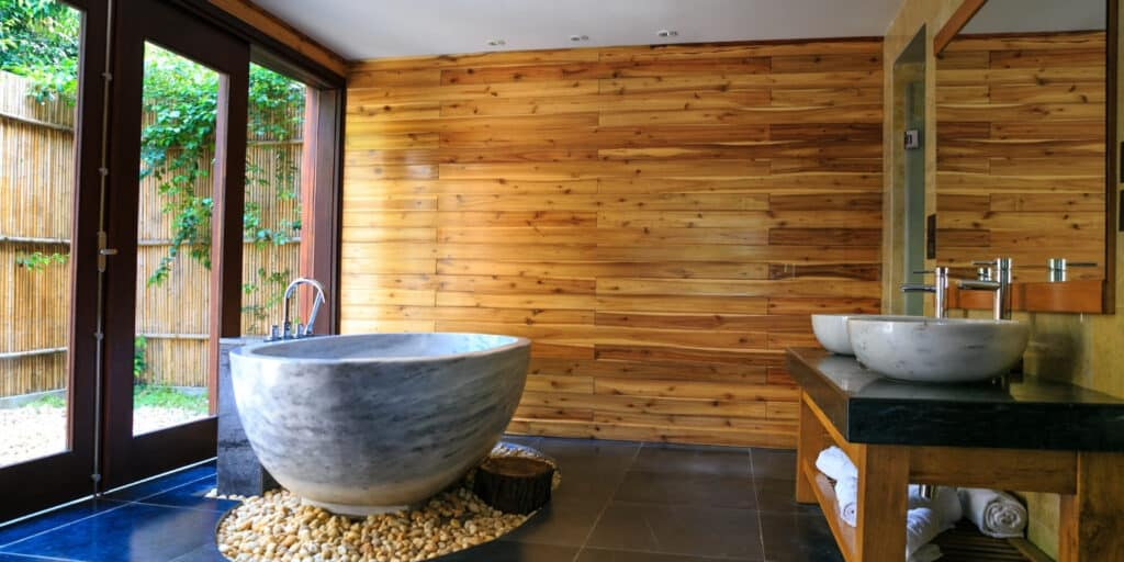 biophilic bathroom with tub and windows