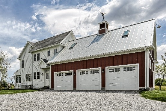 3 car garage with white doors attached to a hoem