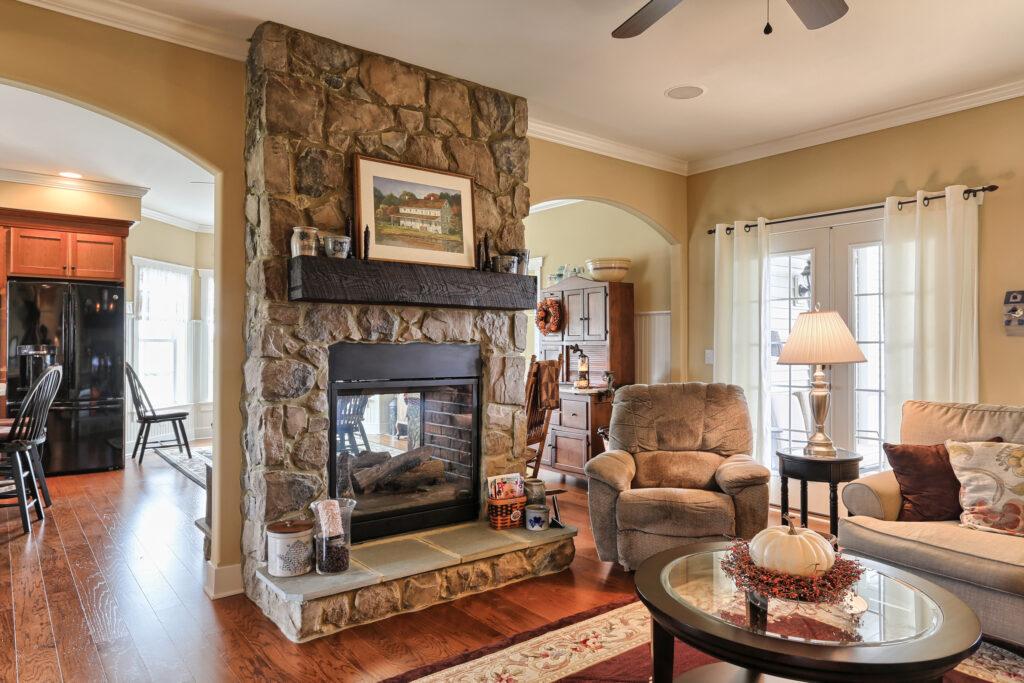 stone-surround-two-sided-fireplace-wood-mantel